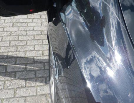 Lackschaden an der Fahrerseite hinten